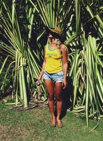 Beyonce in Portland, Jamaica, soaking up some sun with a Red Stripe in hand.